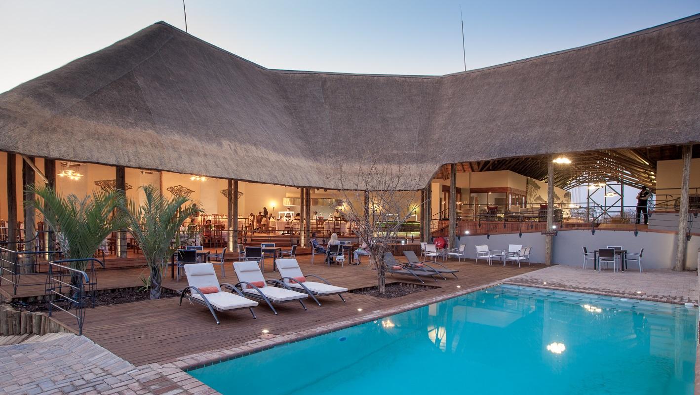 Chobe Bush Lodge - The pool and dining area