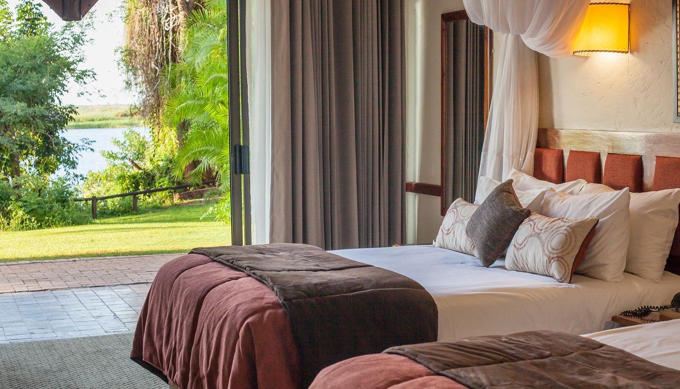 Chobe Safari Lodge - a bedroom with a view