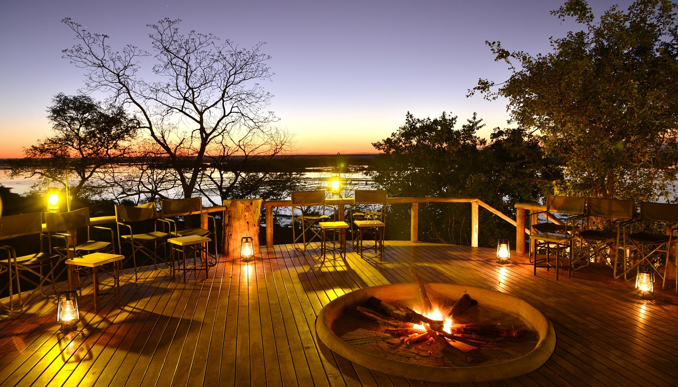 Muchenje's fire pit deck at night